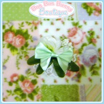 Cute Little Green Bow with White Flowers