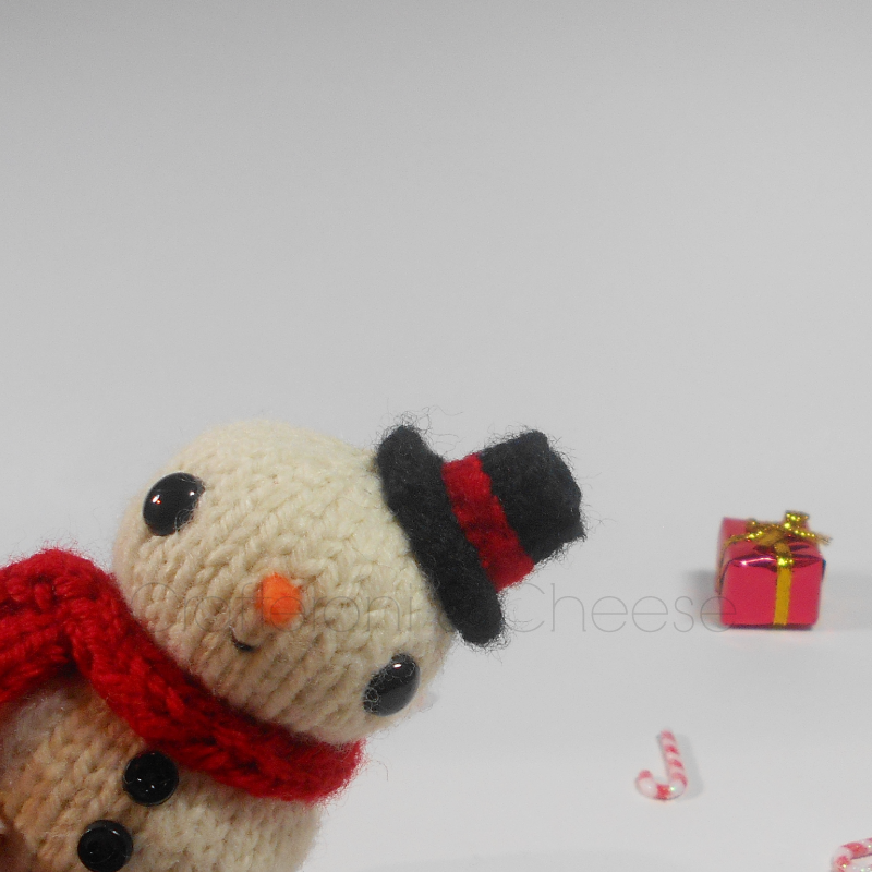 http://crafteroniandcheese.storenvy.com/products/10733529-amigurumi-knit-snowman-plush