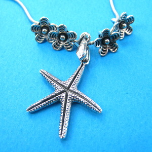 Pretty Floral Starfish Charm Necklace in Silver