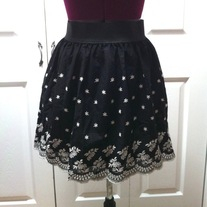 In M & L - black off white flower embroidered mini scallop border skirt
