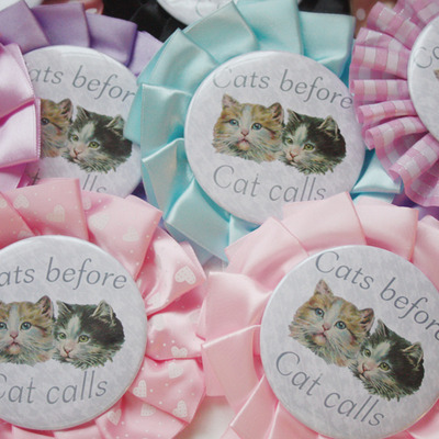 """cats before cat calls"" rosette pin"