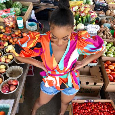 Ario peplum wrap blouse orange