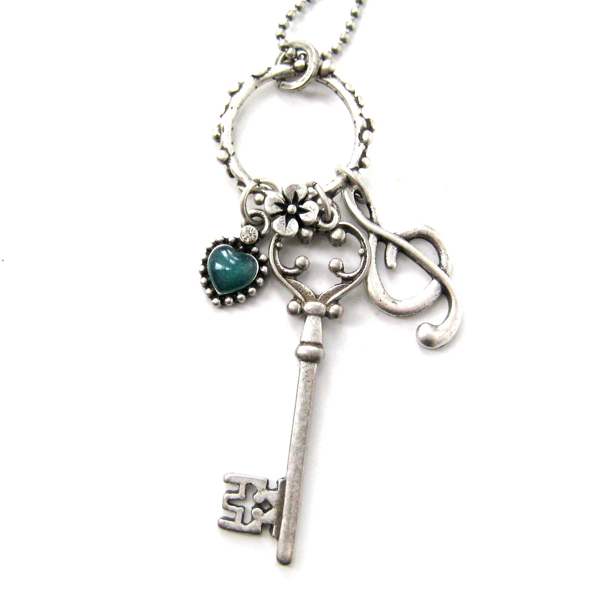 skeleton key and treble clef themed necklace in