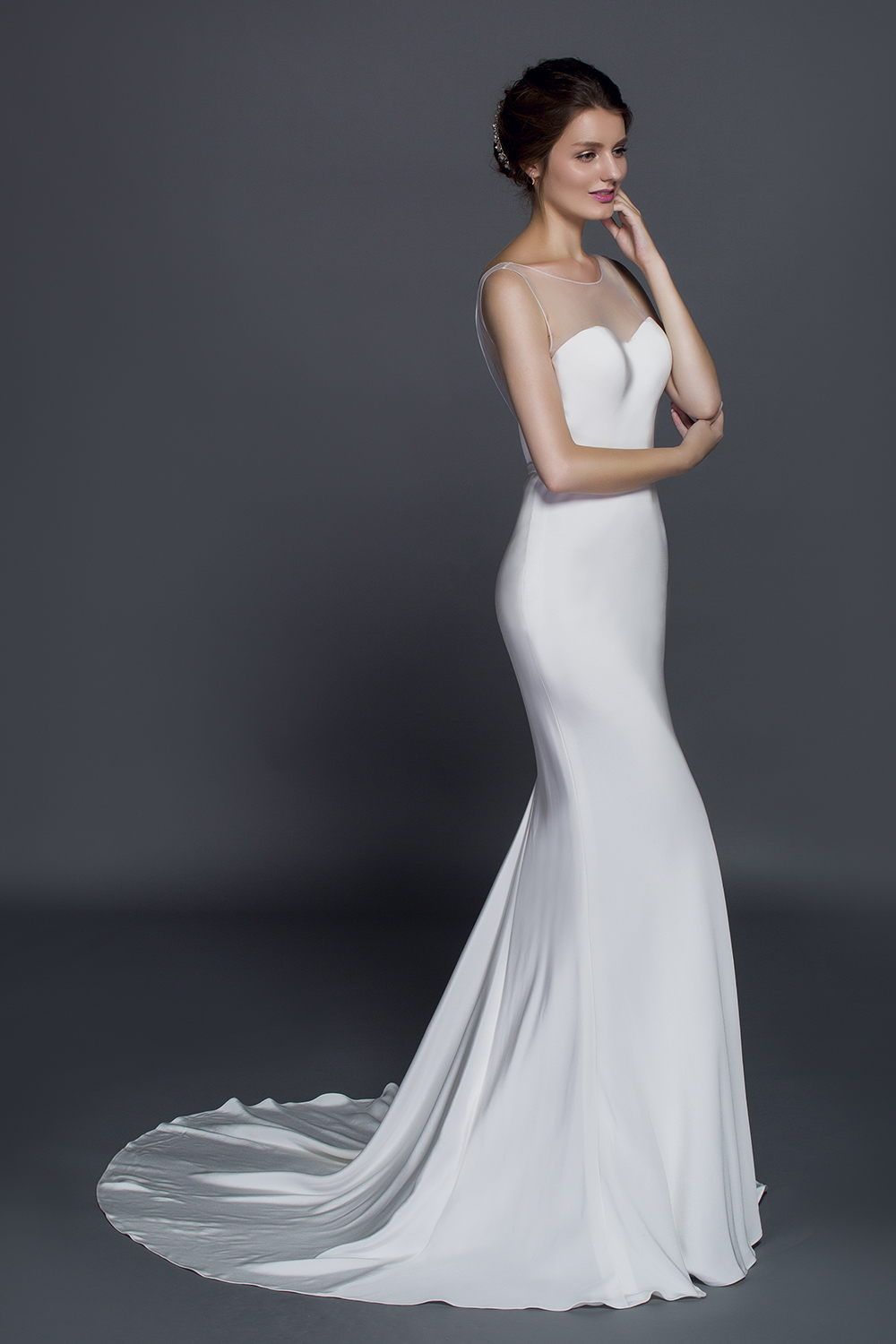 plus size silk crepe wedding gown with sheer illusion neckline and dainty  belt from curvy brides