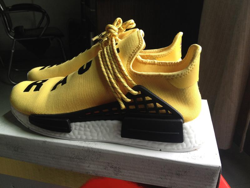 5d8cf0f96eec2e Authentic UA Adidas NMD Human Race- Yellow Black on Storenvy