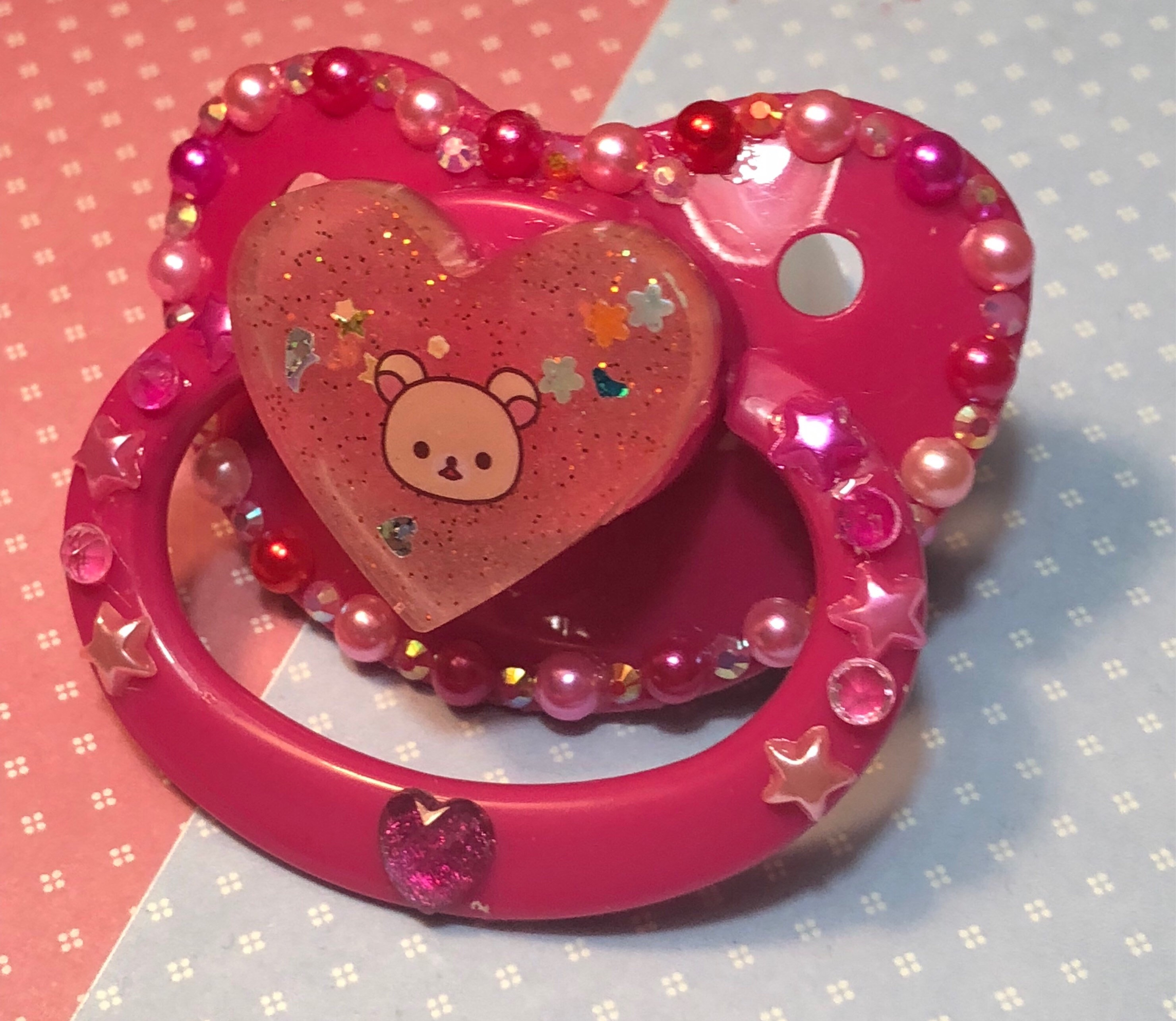 Abdl/Ddlg Hot pink glow in the dark Korilakkuma adult pacifier sold by  Andiel and Owen