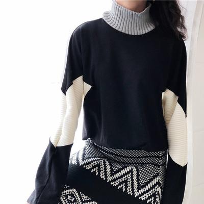 d4d977738e76 Black and white stitching geometric pattern turtleneck bat long sleeve  sweater